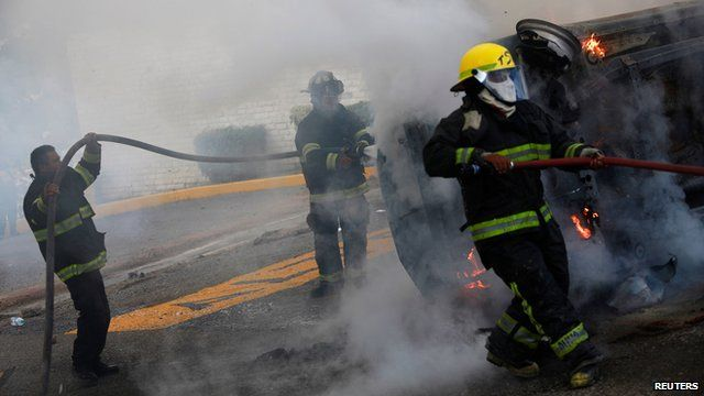 Fire officers tackle blaze after clashes between police and students