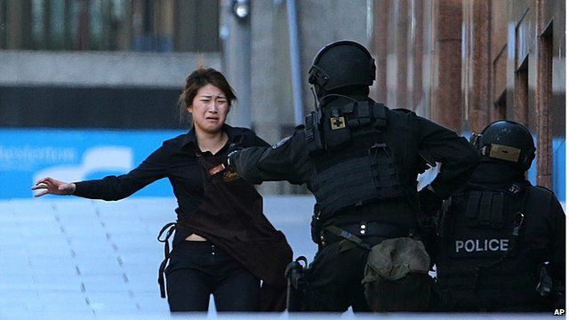 Fleeing hostage runs to armed policeman outside Sydney cafe