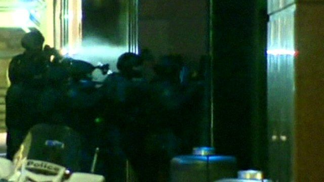 Police storm the cafe in Sydney