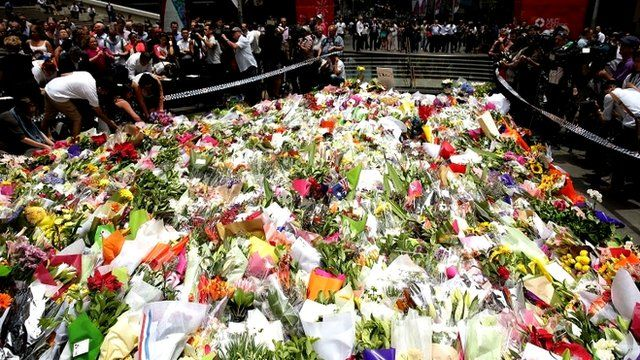 Flowers placed at scene of siege