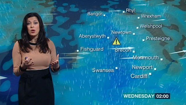 BBC Wales weather presenter Behnaz Akhgar with a weather map