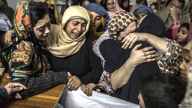 Women mourn their relative Mohammed Ali Khan, 15, a student who was killed during an attack by Taliban gunmen