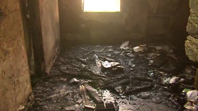 Burned out room in Pakistan school attacked by Taliban, showing debris