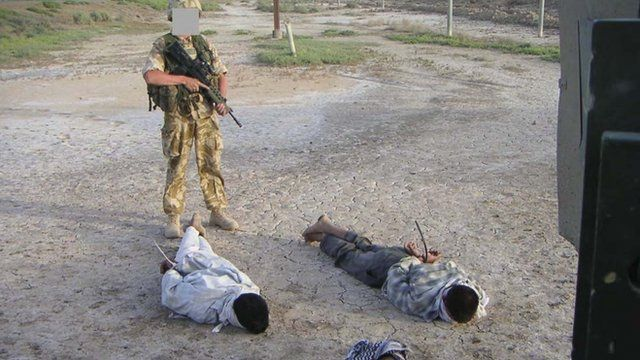 British soldier with Iraqi detainees