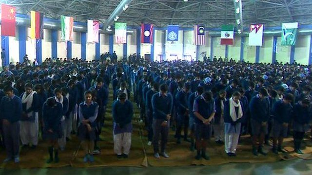 Students at a school in Delhi hold prayers to mark a deadly attack on a school in Pakistan
