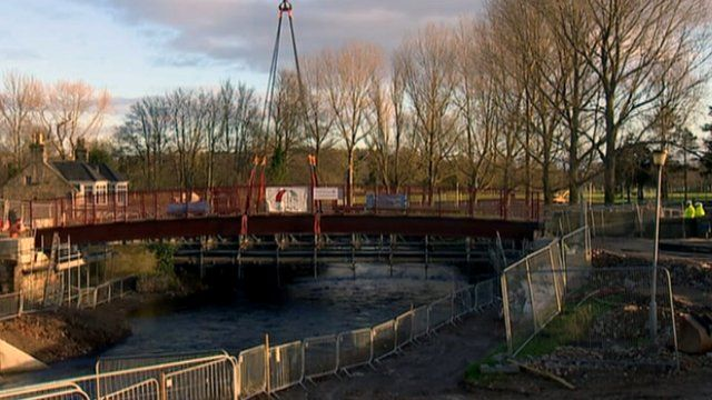 Bridge lifted into place