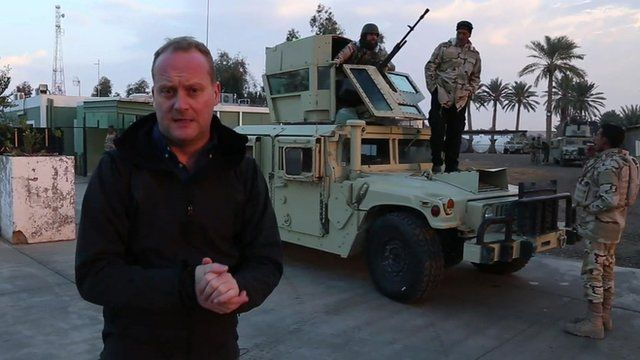Quentin Sommerville in front of military vehicle at Ain al-Asad airbase