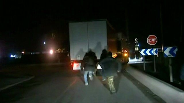 Migrants try to get into a lorry