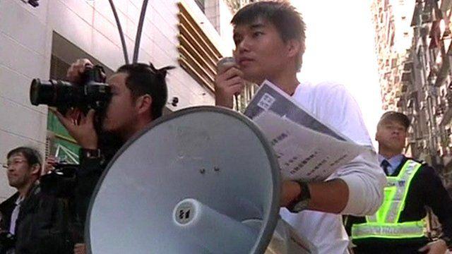 Sulu Sou (right) leads the protest in Macau
