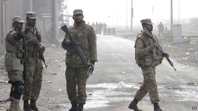 Pakistan army troops stand guard at a road leading to the central prison on the outskirts of Lahore