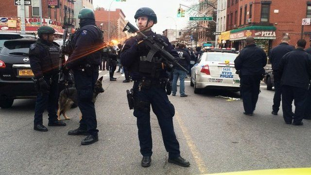 Police officers block off the scene of the shooting incident