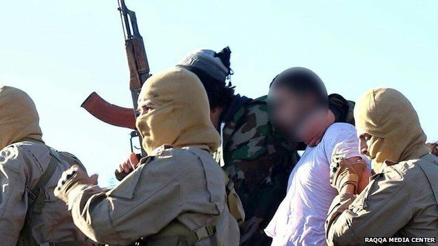 Photo posted online by Raqqa Media Center purportedly showing Jordanian pilot captured by Islamic State militants near the Syrian city of Raqqa (24 December 2014)