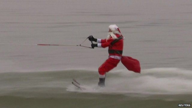 'Santa Claus' water skis at an event on the Potomac River in Old Town Alexandria, Virginia