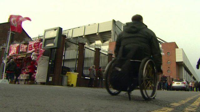 Wheelchair using fan outside a sports ground
