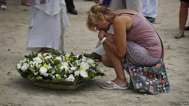 Relative holds back tears at ceremony for German, Austrian and Swiss victims of the Asian tsunami, in Khao Lak
