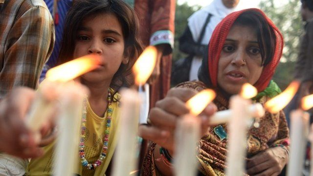 Candles lit for victims of school massacre
