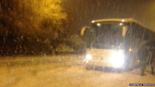 A coach on a snow-covered road
