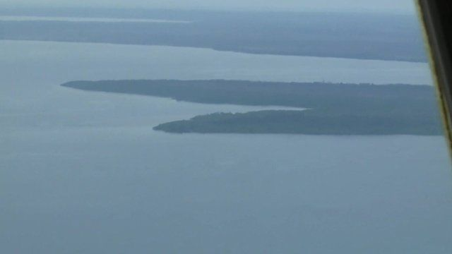 View of sea and land from Indonesian military plane search for AirAsia QZ8501