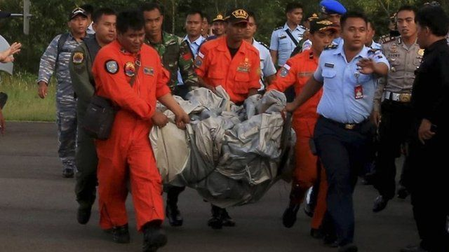 Members of the Search and Rescue Agency SARS carry debris recovered from the sea from missing Indonesia Air Asia flight QZ 8501 at Pangkalan Bun, Central Kalimantan, December 30, 2014