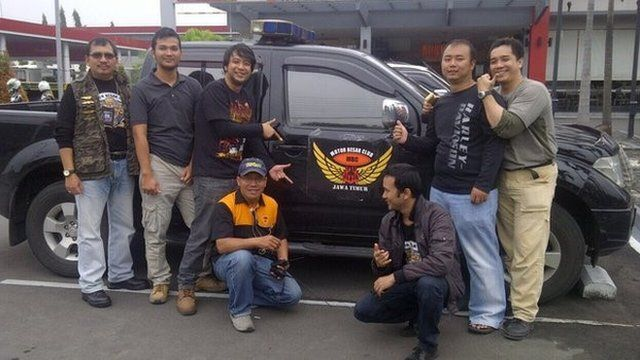 Capt Iriyanto (L) pictured with friends