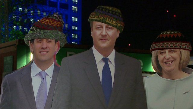 Cardboard statues of political leaders in hats