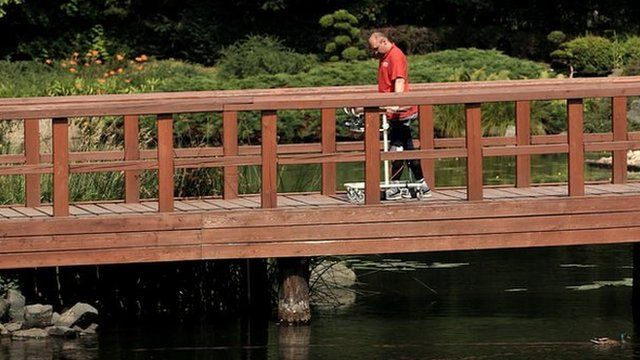 Darek Fidyka walks on bridge