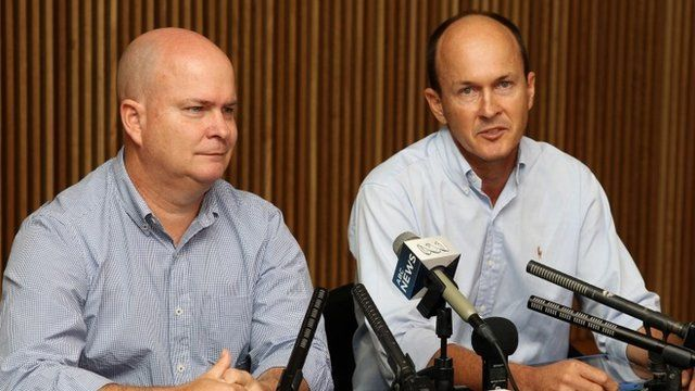 Peter Greste's brothers Andrew (right) and Mike