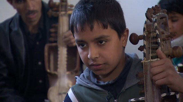 Afghan music student Ghufran Umar who is learning the sarinda