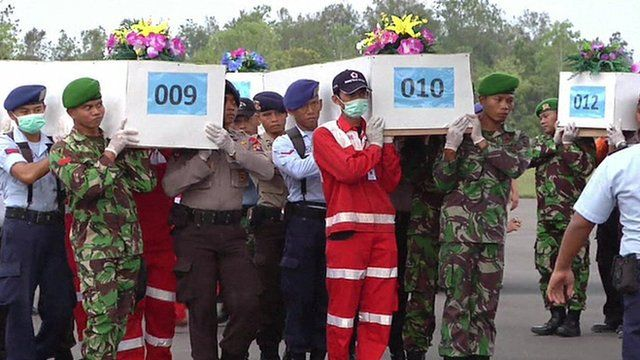 Coffins of the dead from the AirAsia flight