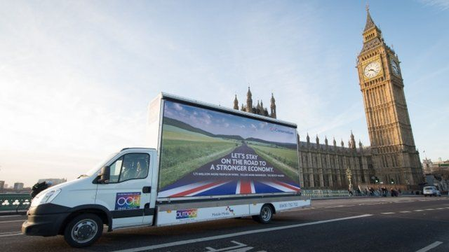 Conservative Party election poster driving past Houses of Parliament