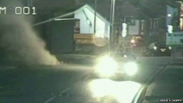CCTV footage of streetlight and dust as building collapses on road in Wrexham