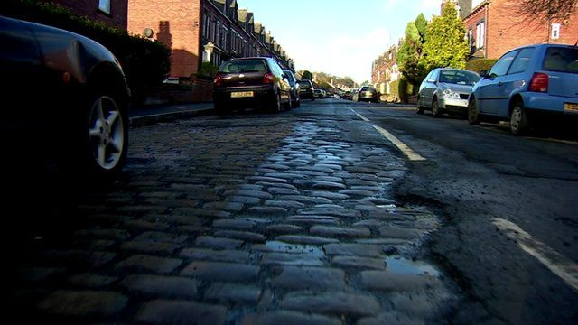 A road in Leeds where the 19th century cobbles have been exposed.