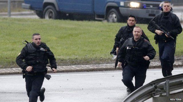 Members of the French gendarmerie intervention forces arrive in Dammartin-en-Goele