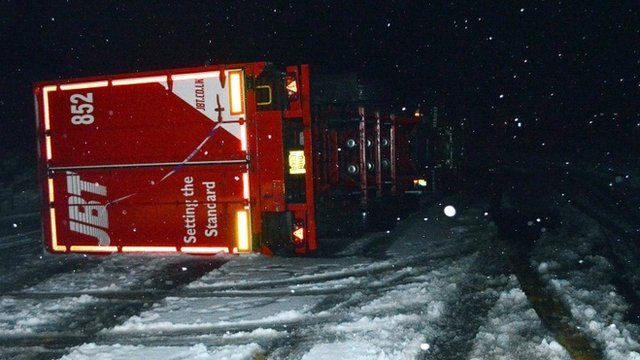 Overturned lorry in snow in Drumochter, Scottish Highlands