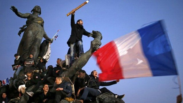 A man holds a giant pencil as he takes part in a solidarity march (Marche Republicaine) in the streets of Paris January 11, 2015