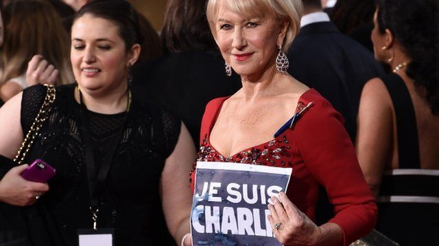 "Dame Helen Mirren, right, holding banner reading ""Je suis Charlie"""