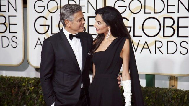 Actor George Clooney and wife, Amal Clooney, arrive at the 72nd Golden Globe Awards in Beverly Hills, California January 11, 2015
