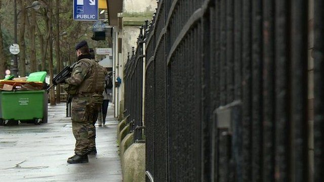 French soldiers outside school
