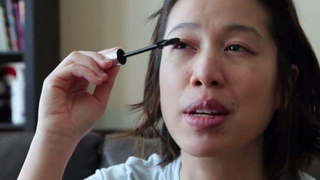 Christine Ha putting her mascara on