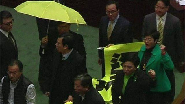 Pro-democracy MPs march through Hong Kong's legislature