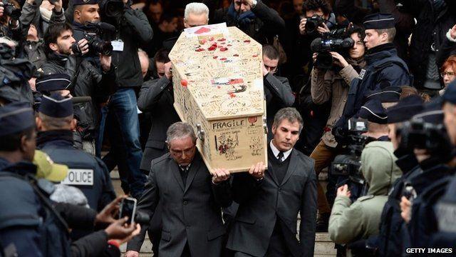 The coffin of Bernard Verlhac - known as Tignous