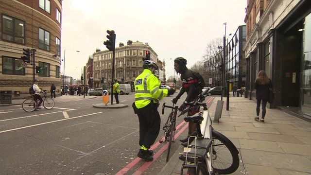 Police officer talking to cyclist