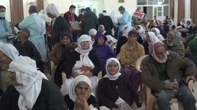 Released Yazidis in a room with medical staff