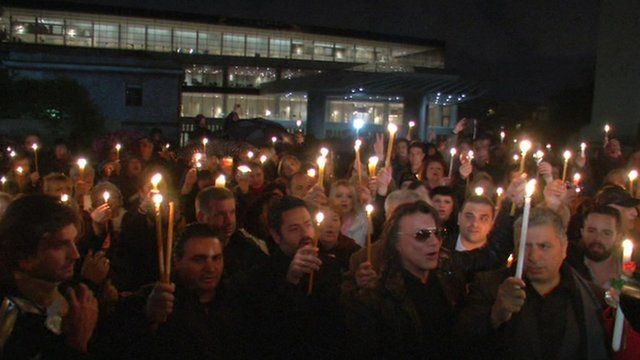 Crowd holding candles