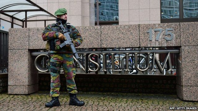 A Belgian soldier patrols outside the European Council headquarters in Brussels on January 19