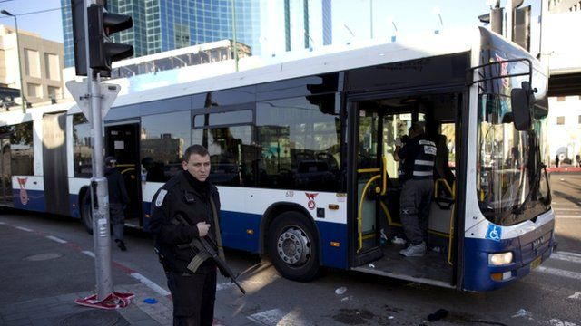 An Israeli police officer secures the scene after a stabbing in Tel Aviv