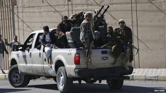Houthi fighters on truck outside presidential palace in Sanaa