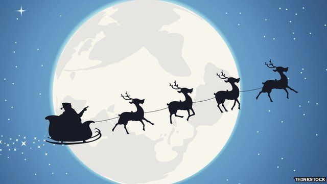 Father Christmas and reindeers silhouetted against the moon