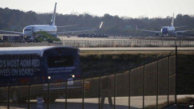 A Delta plane (left) and a Southwest flight sit on the tarmac at Atlanta's Hartsfield-Jackson International Airport. Photo: 24 January 2015