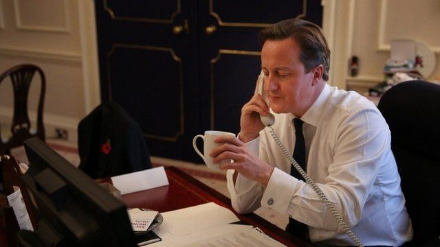 British Prime Minister David Cameron talks to US President Barack Obama on the telephone from his office in Downing Street on November 8, 2012 in London, England
